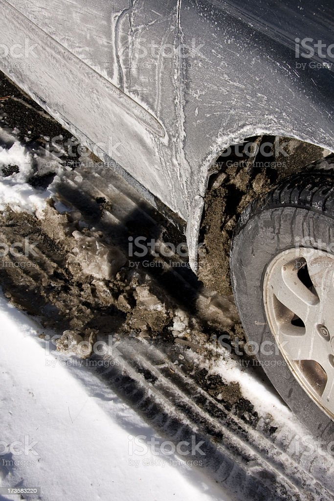 car with slush, snow and salt stock photo