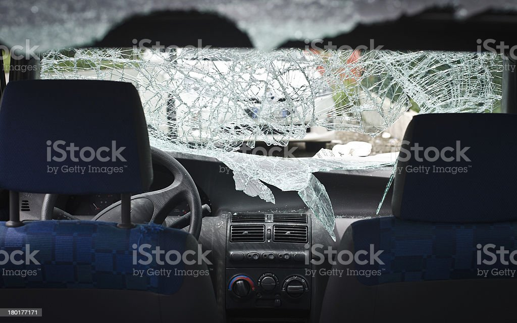 Car with smashed windshield stock photo