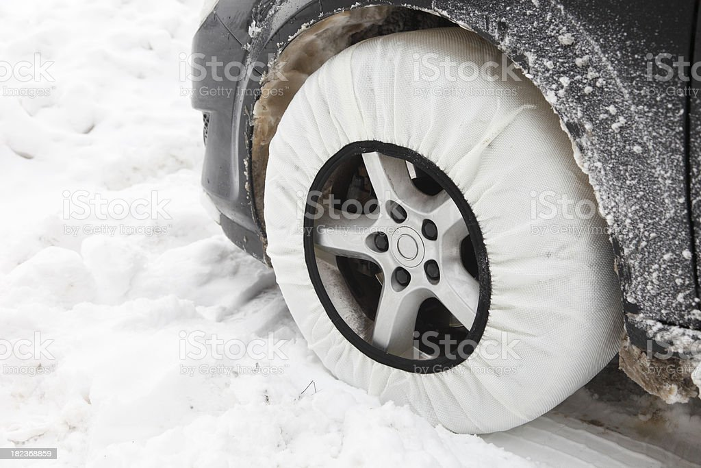 Car with textile tire chain royalty-free stock photo