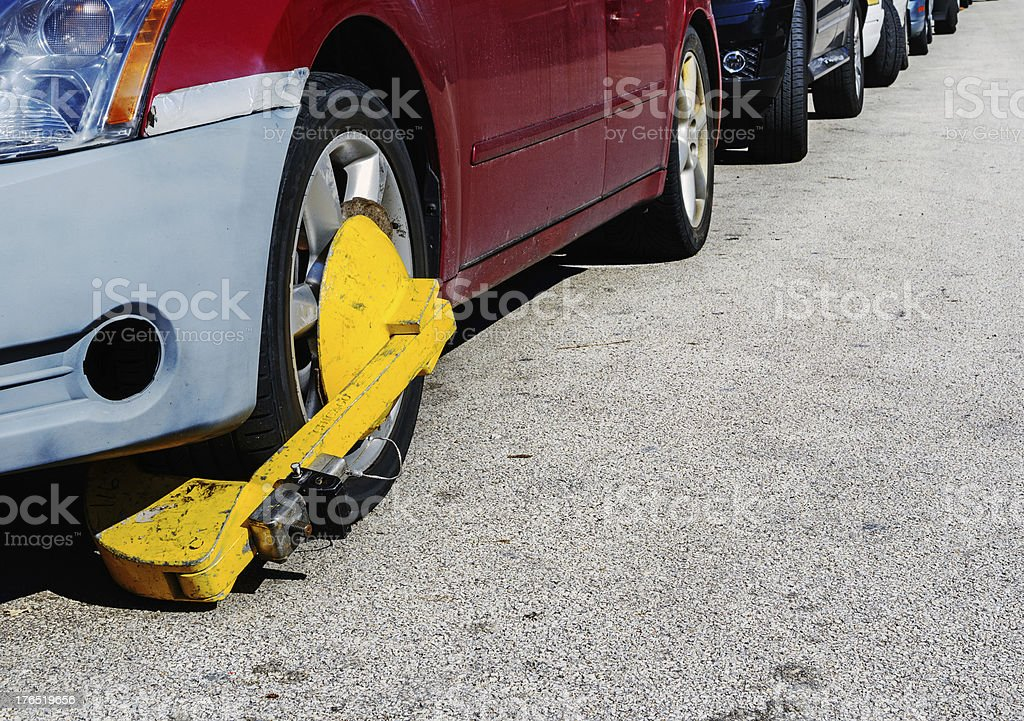 Car with Wheel Clamp in Chicago stock photo