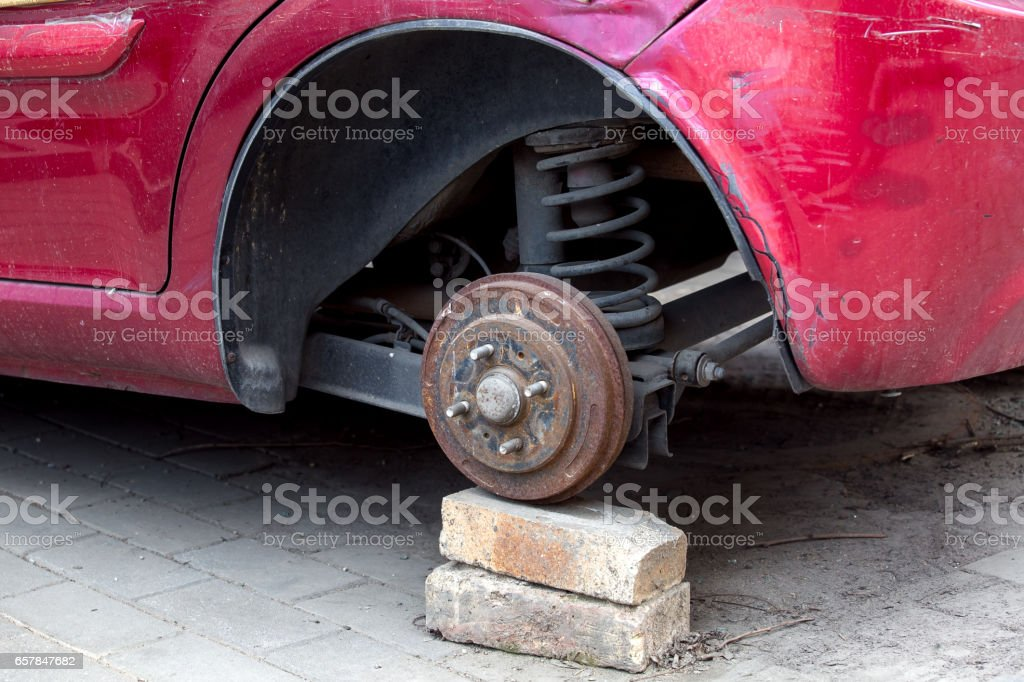 Car without wheels costs on brick. stock photo