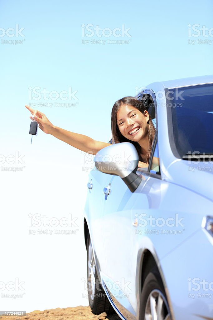 Car woman showing keys stock photo