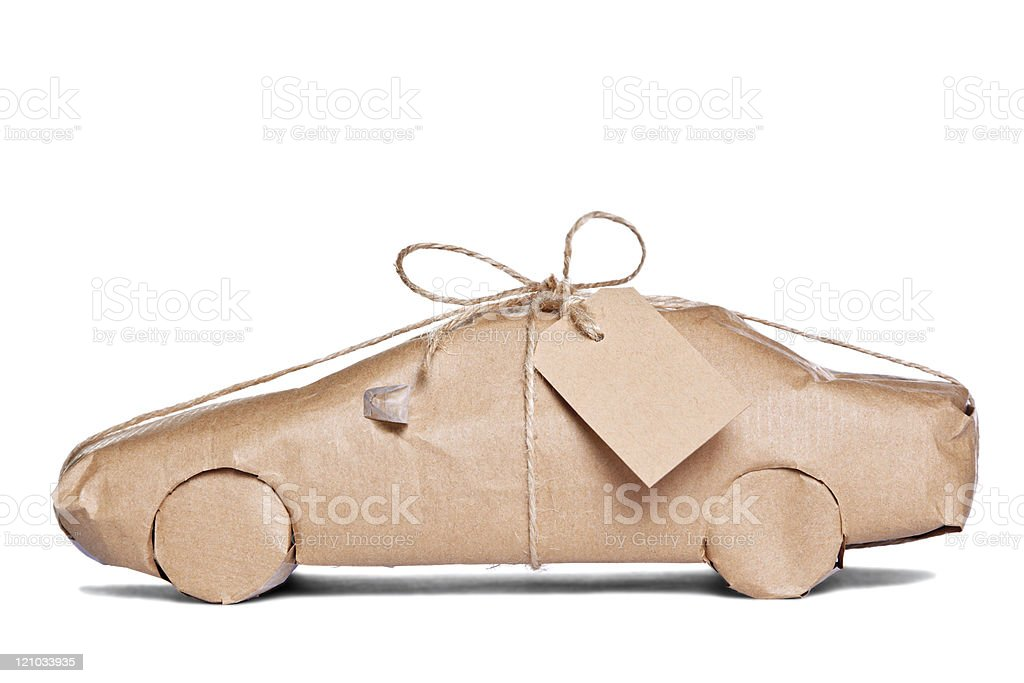 Car wrapped in brown paper cut out stock photo