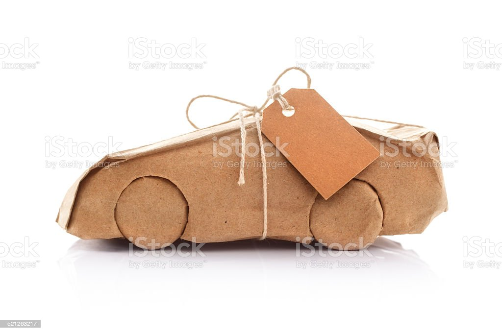 Car wrapped in brown paper stock photo