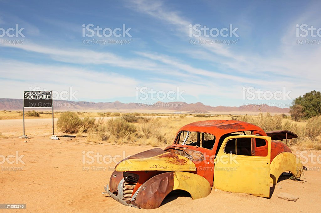 Car Wreck and Solitaire Welcome Sign in Namibia Africa stock photo