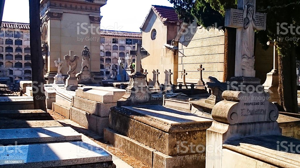 Carabanchel`s Cemetery, Madrid . Graves and tombstones in the morning July stock photo