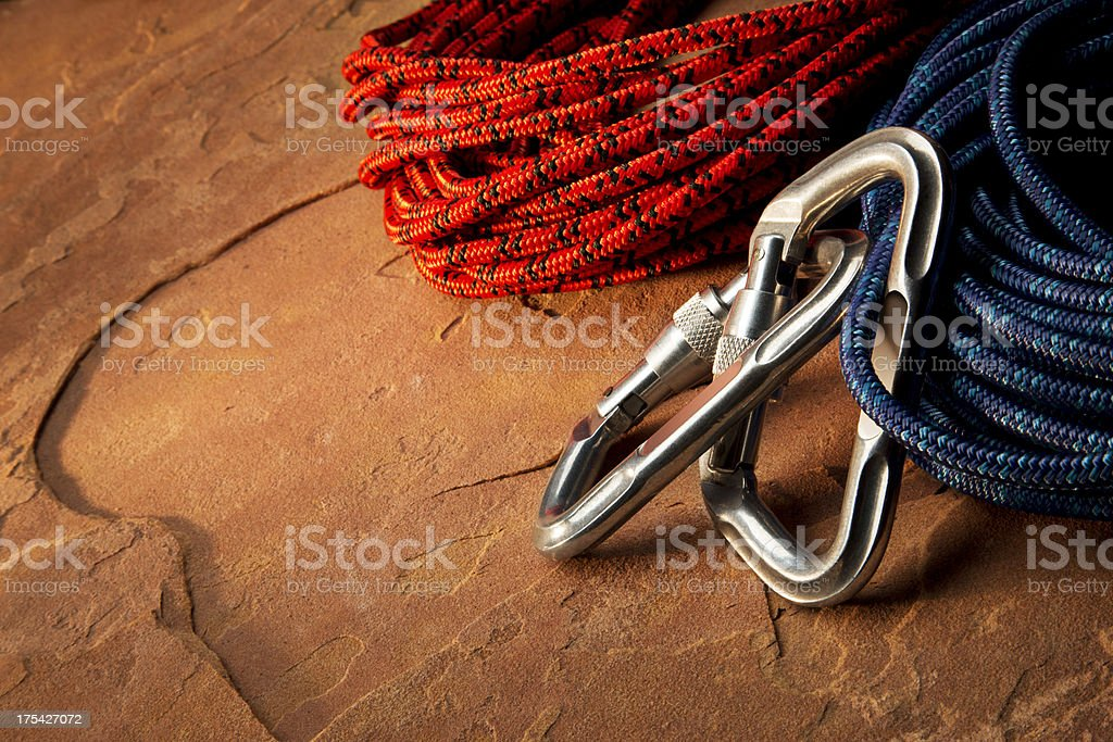 Carabiner Clip and Climbing Rope on Red Rock stock photo