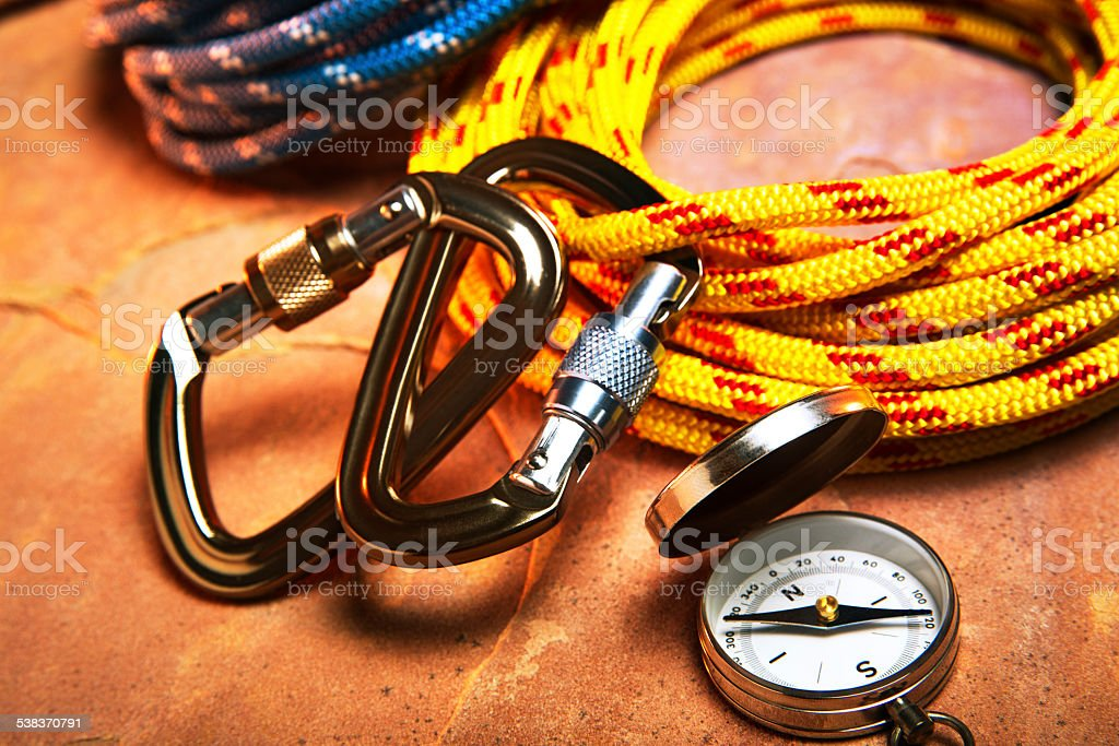 Carabiner Clips and Climbing Rope on Red Rock stock photo