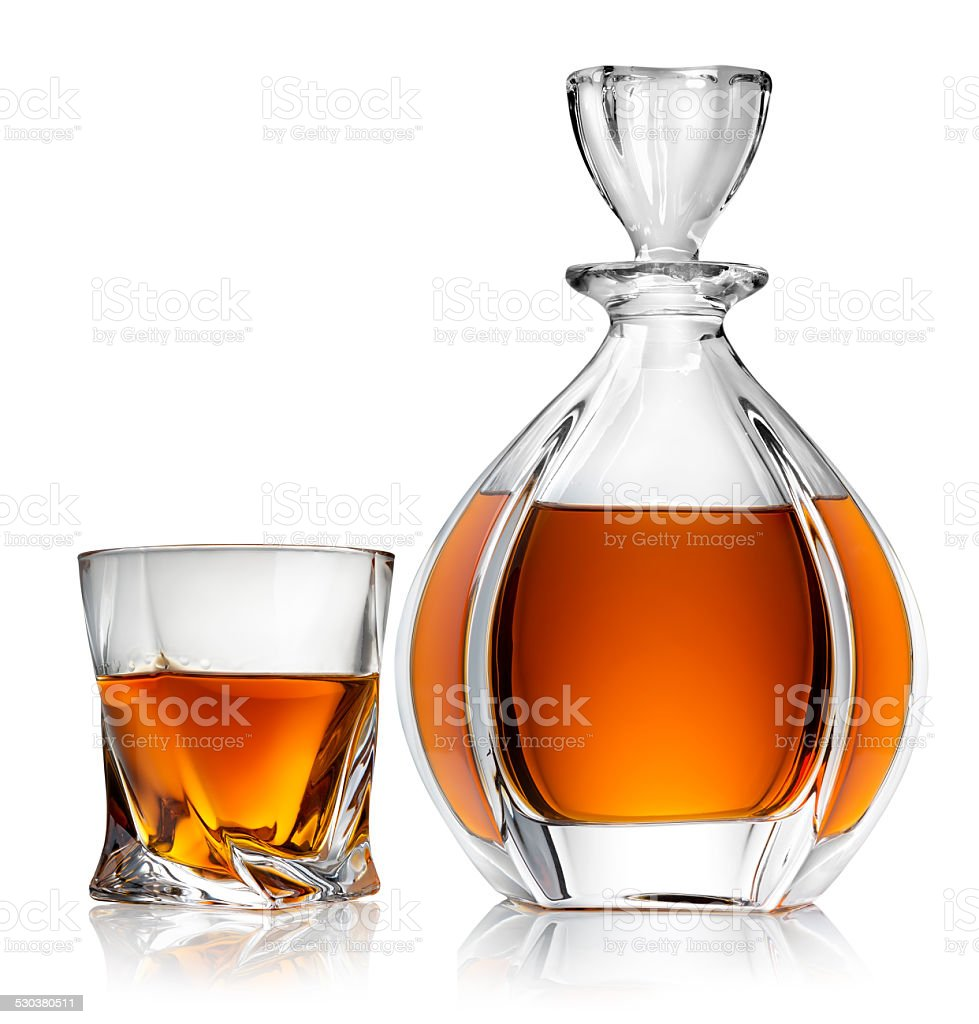 Carafe and glass of whiskey stock photo