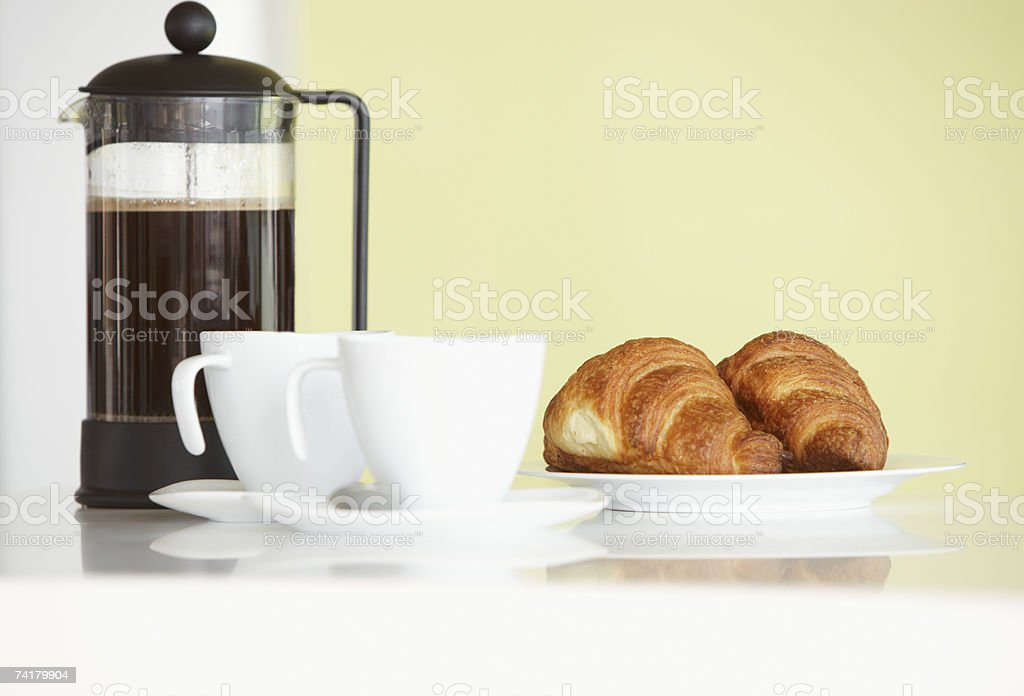 Carafe with coffee cups and croissants royalty-free stock photo