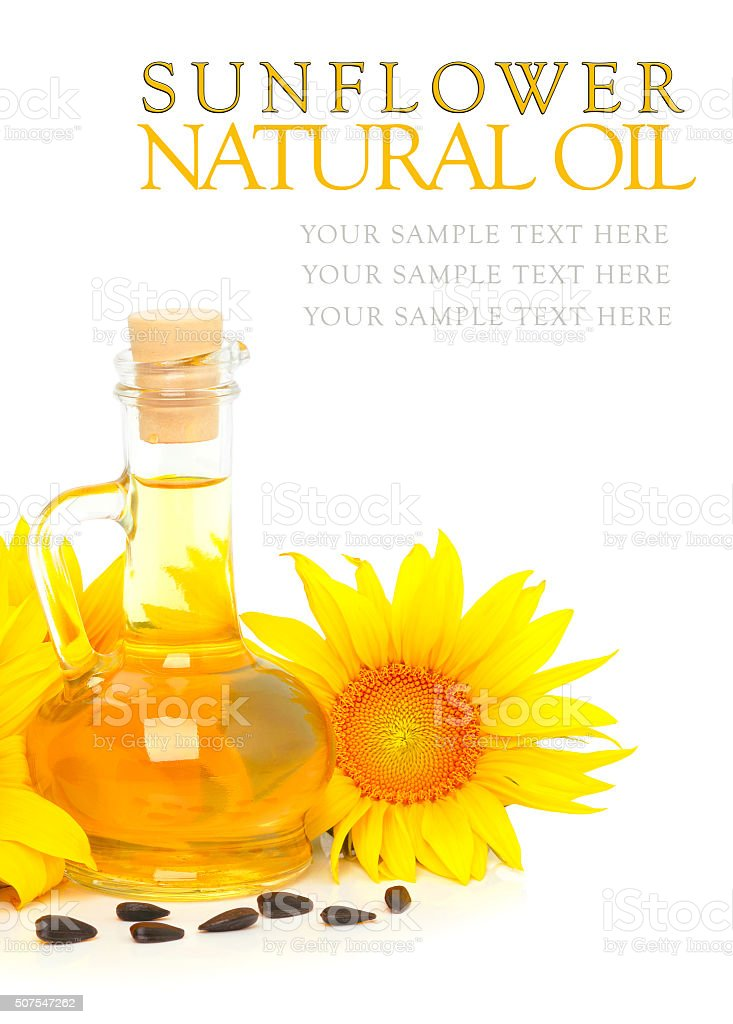 Carafe with vegetable oil and sunflowers stock photo