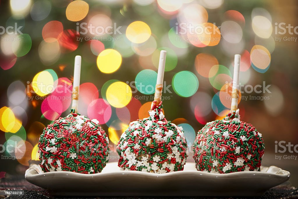 Caramel apples covered with sprinkles stock photo