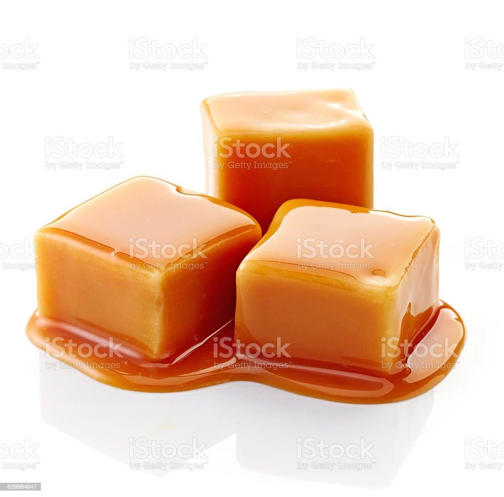 caramel candies and caramel sauce stock photo