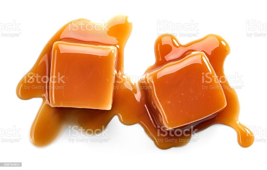 caramel candies and sauce stock photo