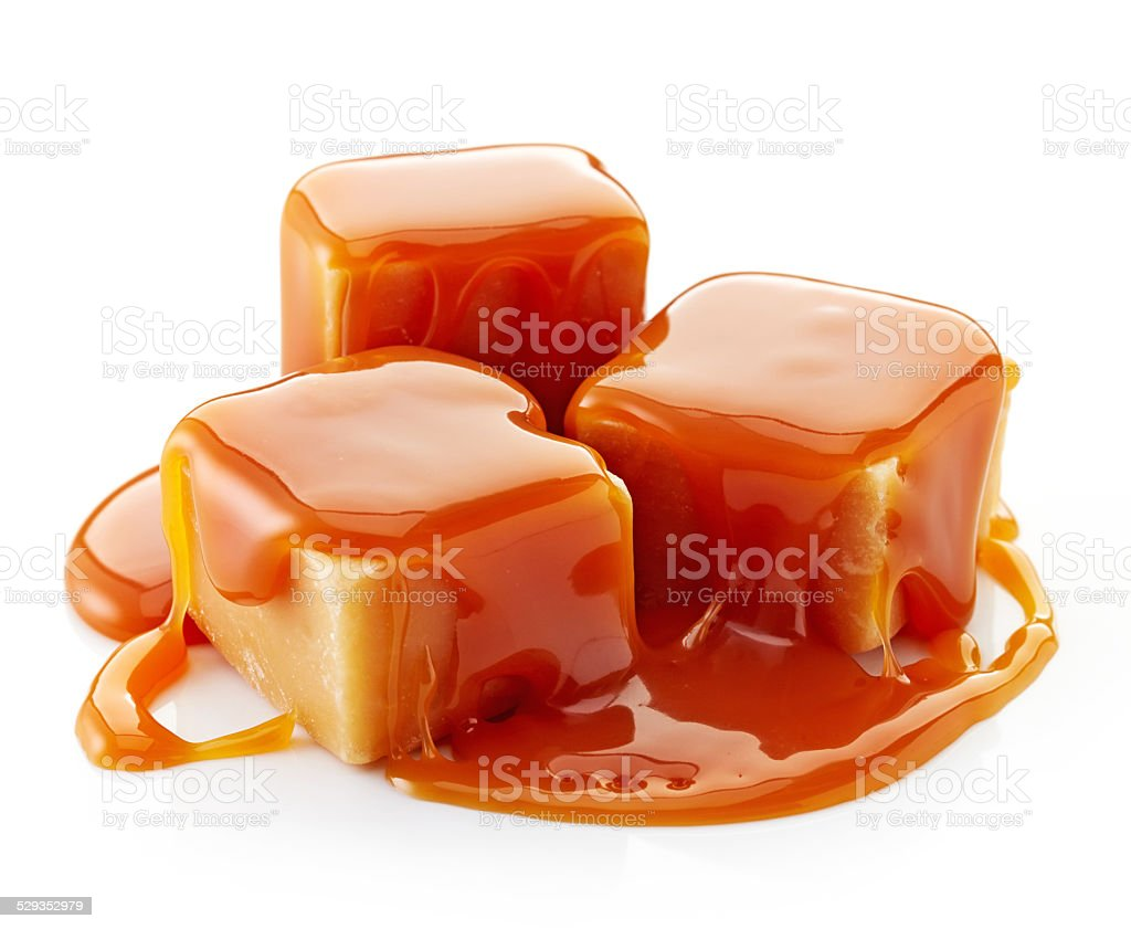 caramel candies and sweet sauce stock photo