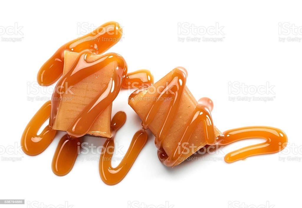 caramel candies on white background stock photo