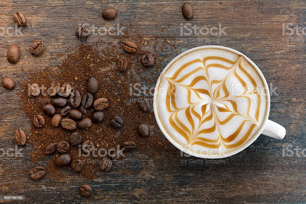 Caramel cappuccino with ground top view. stock photo