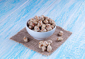 Caramel Coated Peanut with Sesame in blue Wooden Background