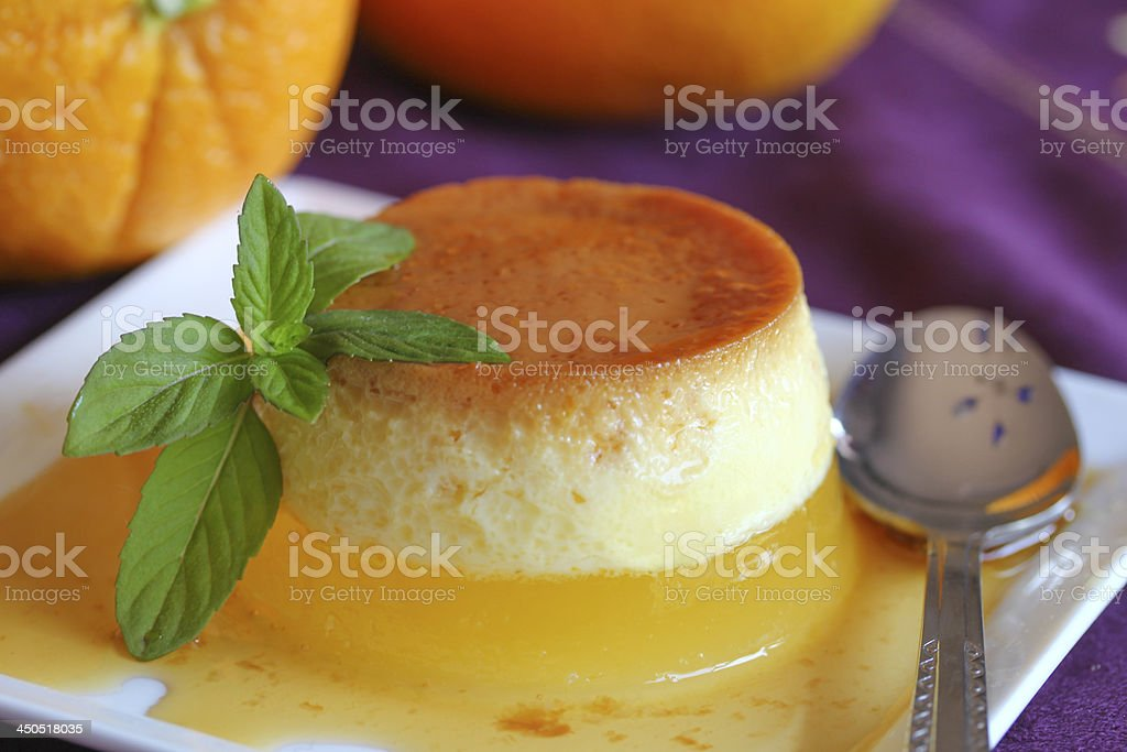 Caramel custard on top of orange jelly royalty-free stock photo