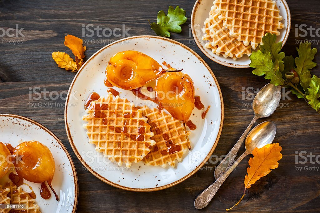 Caramel pears with waffles stock photo