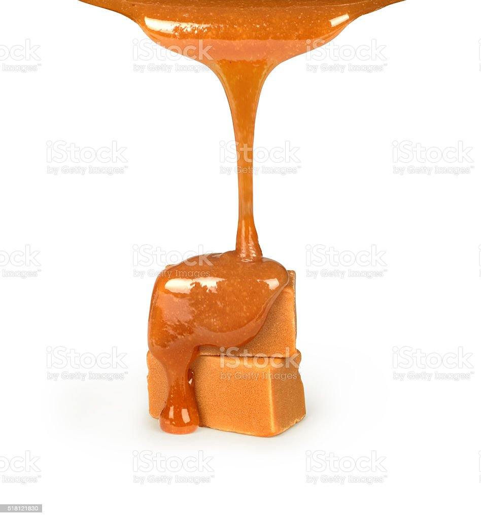 Caramel pouring on  candies stock photo