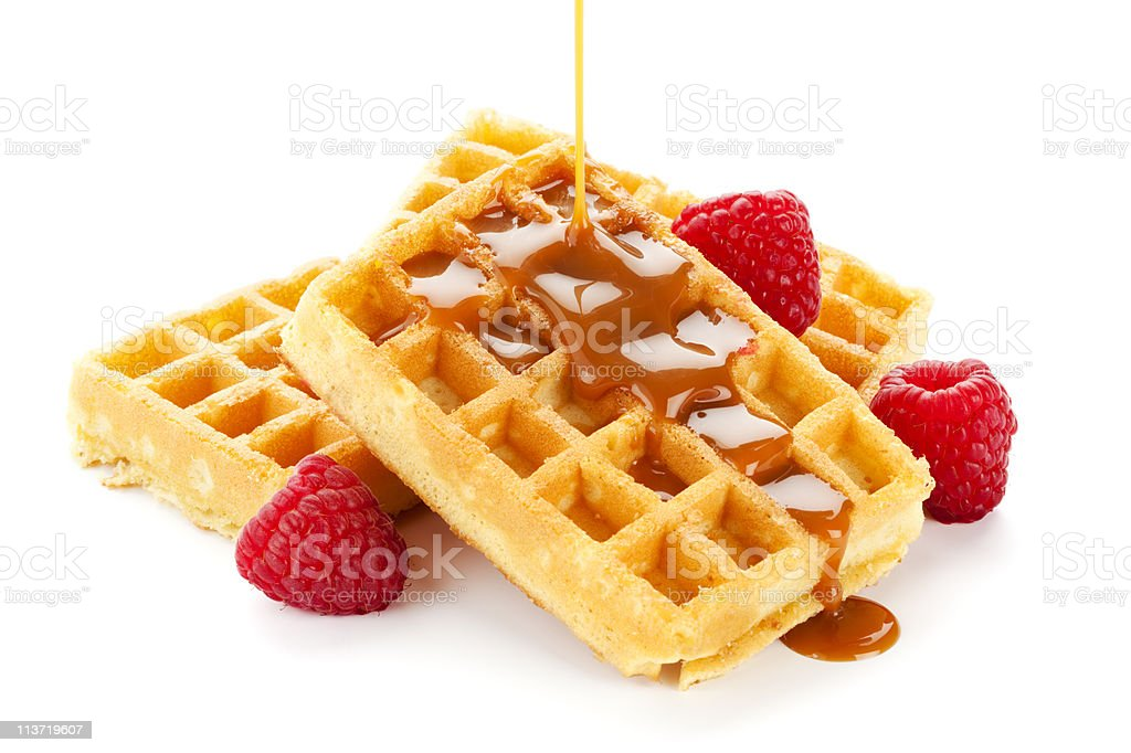 caramel sauce flowing over waffles stock photo