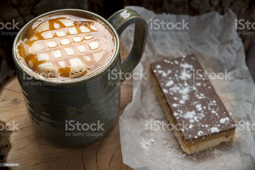 Caramel topped coffee with shortbread stock photo
