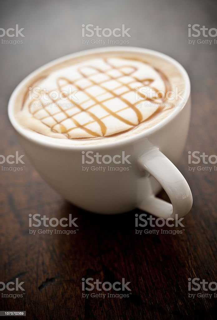 Caramel topped flavoured latte royalty-free stock photo