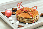 Caramel wafers with marshmallow and сhristmas decorations