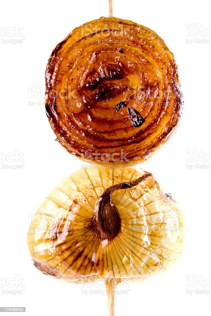 A caramelized onion on a wooden skewer stock photo