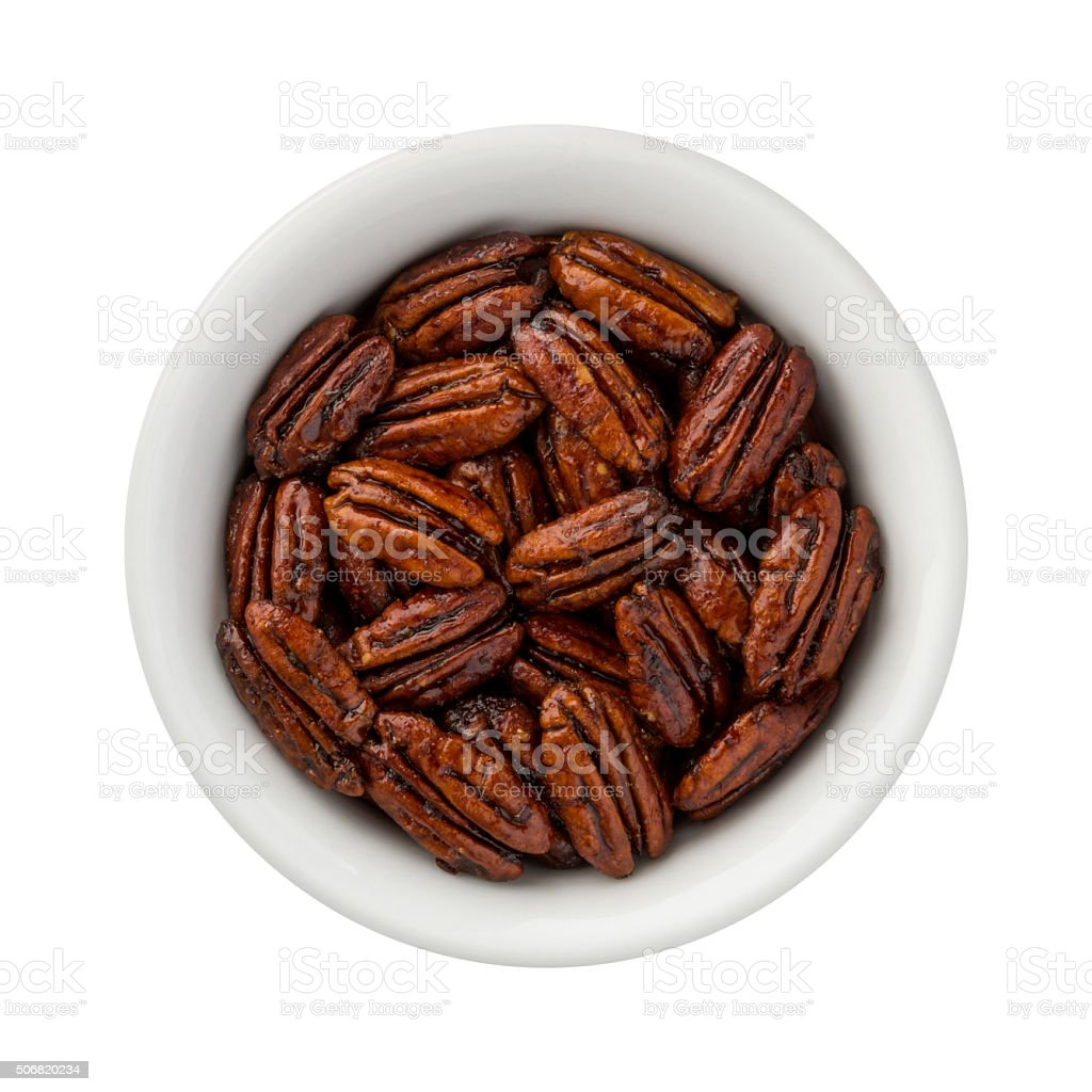 Caramelized Pecans in a ceramic bowl stock photo