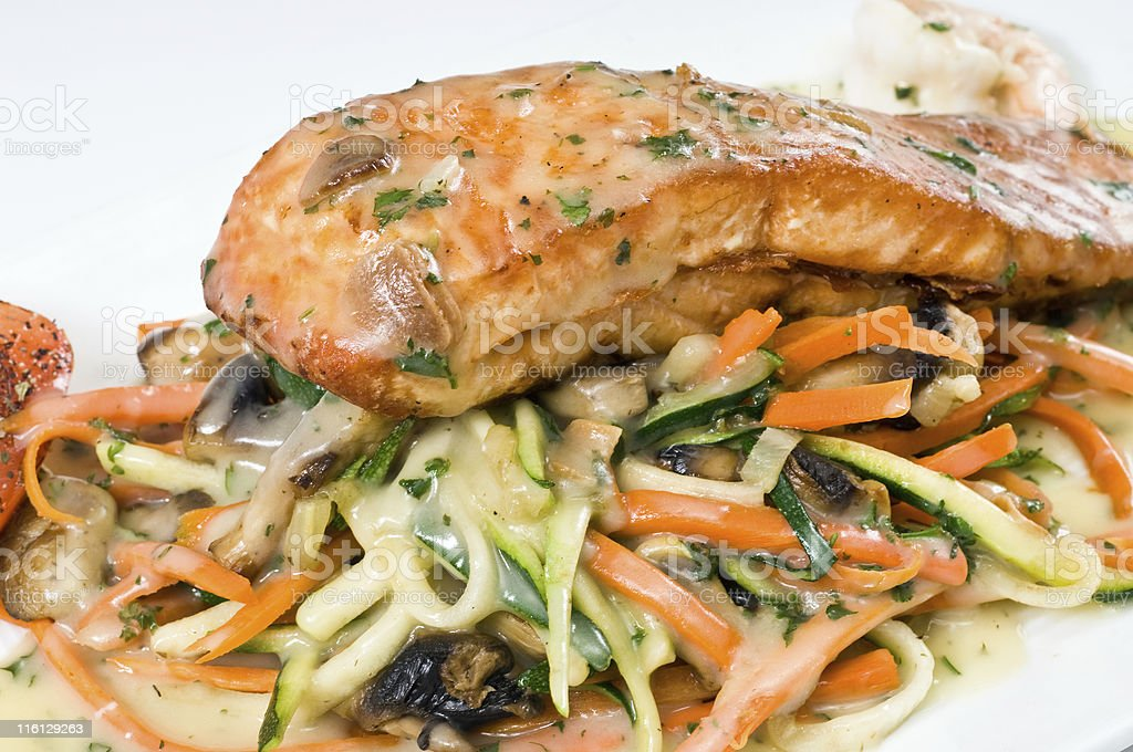 caramelized saute filet of salmon with vegetables royalty-free stock photo