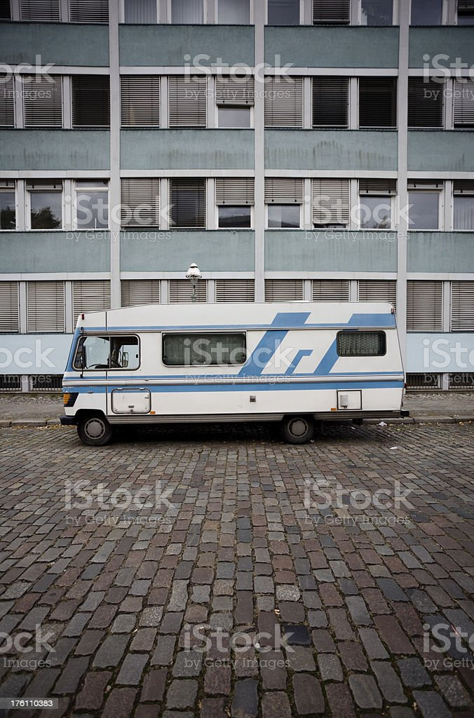Caravan in Front of Apartment Building in Berlin royalty-free stock photo