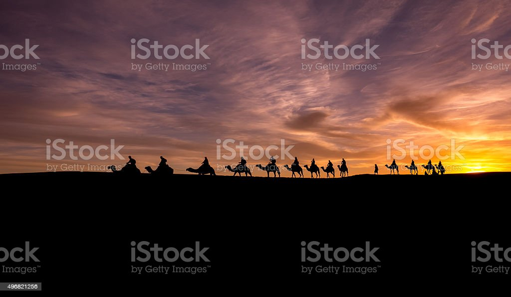 Caravan in Sahara Desert stock photo