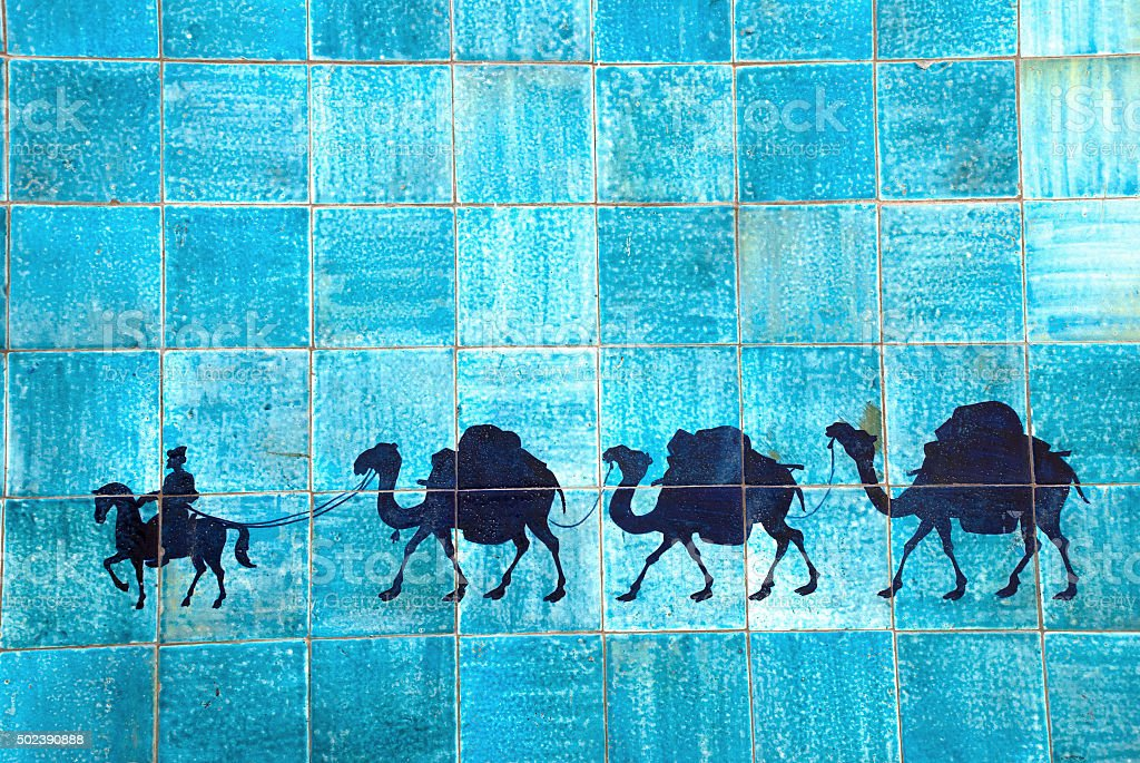 caravan of camels on the ceramic tiles stock photo
