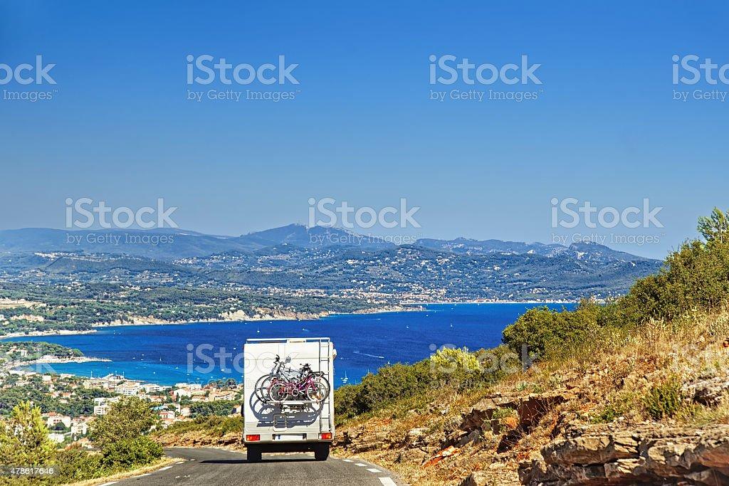 Caravan on the road at the mediterranean shore stock photo