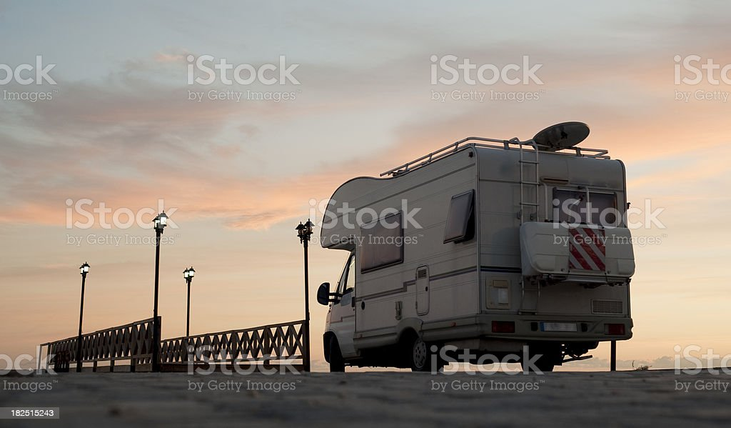 Caravan on the road bridge at sunset royalty-free stock photo