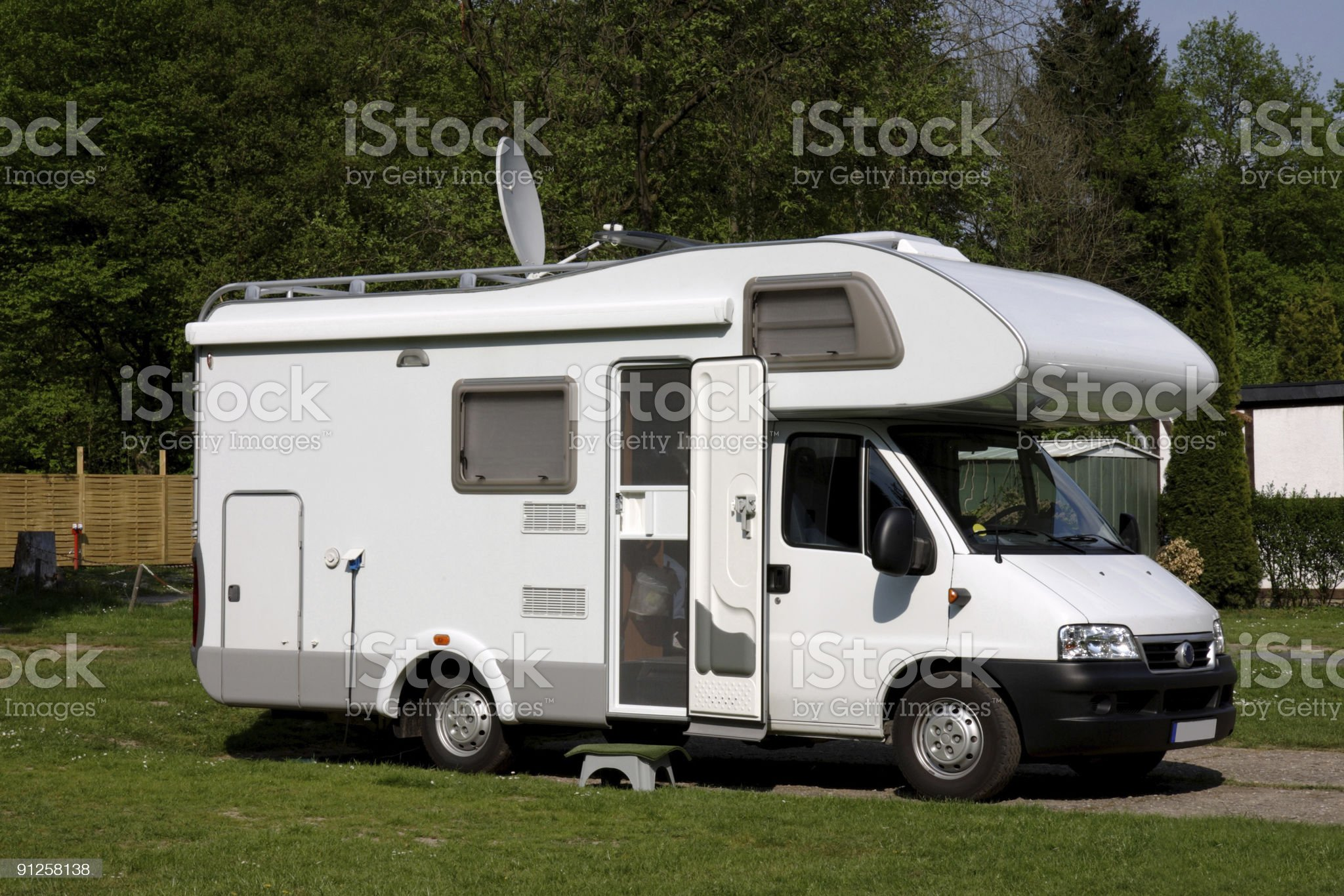 Caravan parked in grassed area royalty-free stock photo