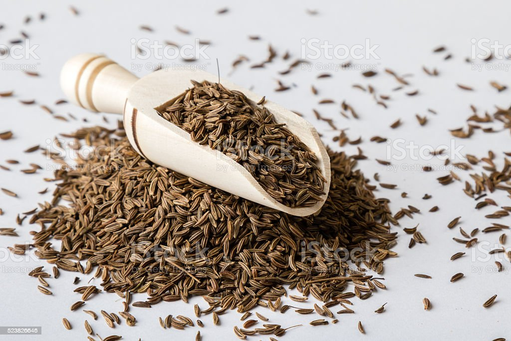 caraway seeds on white table stock photo