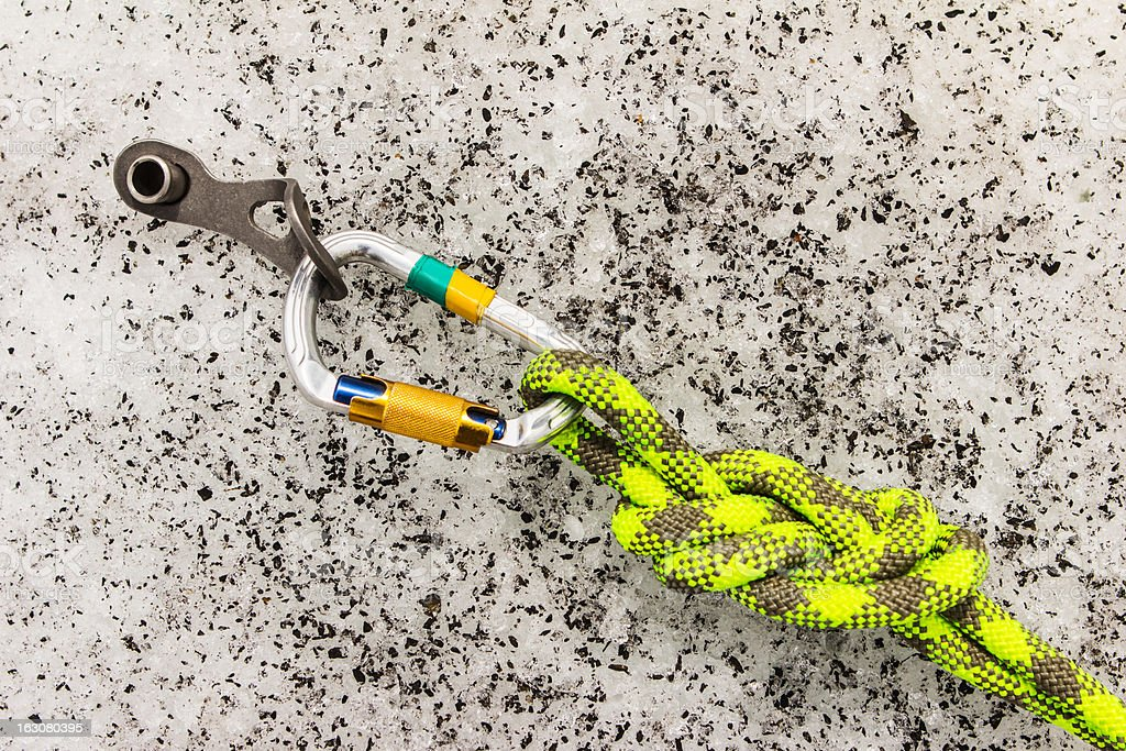 Carbine and hook with rope in ice royalty-free stock photo