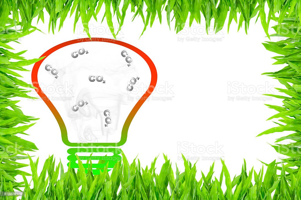 Carbon dioxide in clear light bulb surrounded with green grass stock photo