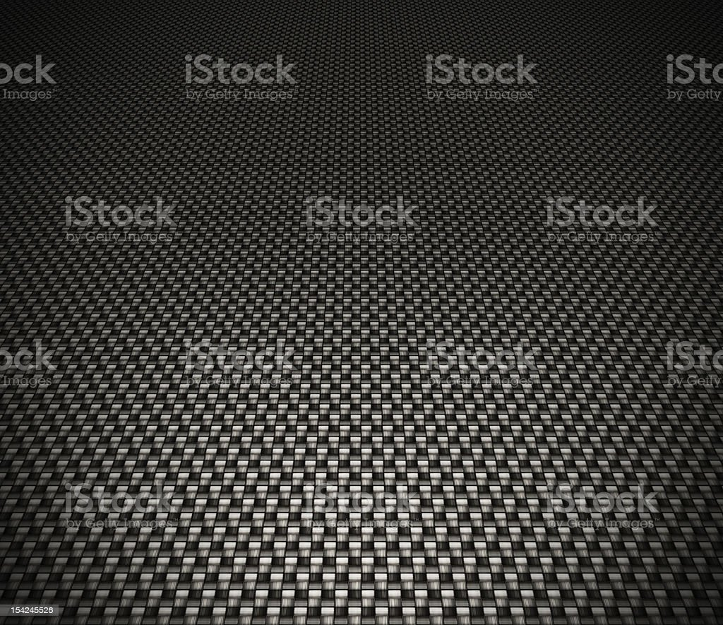 Carbon fiber background in black lit towards the front stock photo