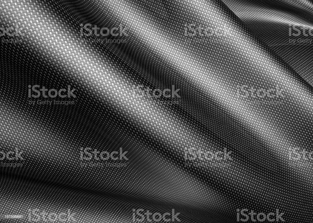 A carbon fiber sheet, about to be molded  stock photo