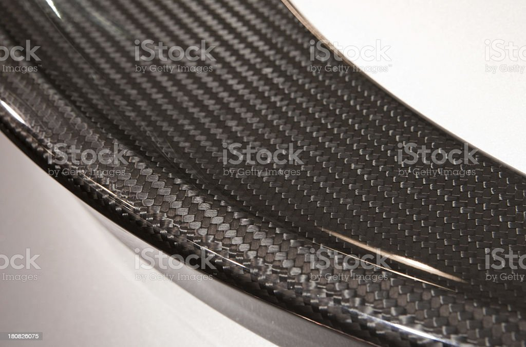 Carbon fiber textured detail on a molded auto part stock photo