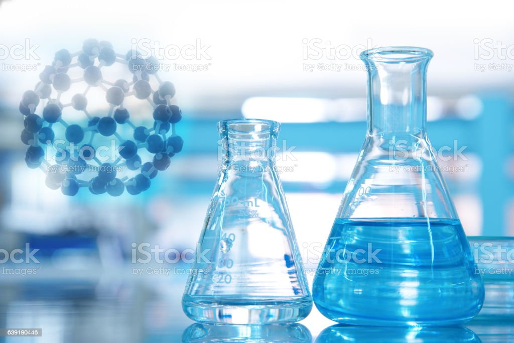 carbon fullerene chemical structure with two flask in science bl stock photo