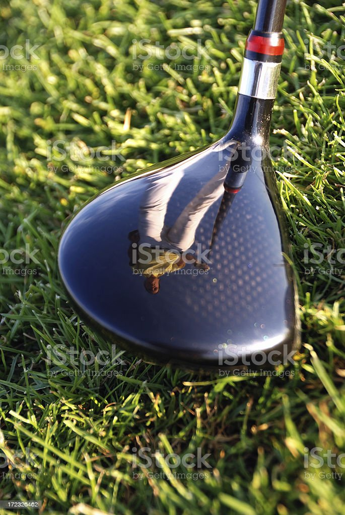 carbon golf club and mirroring girl royalty-free stock photo