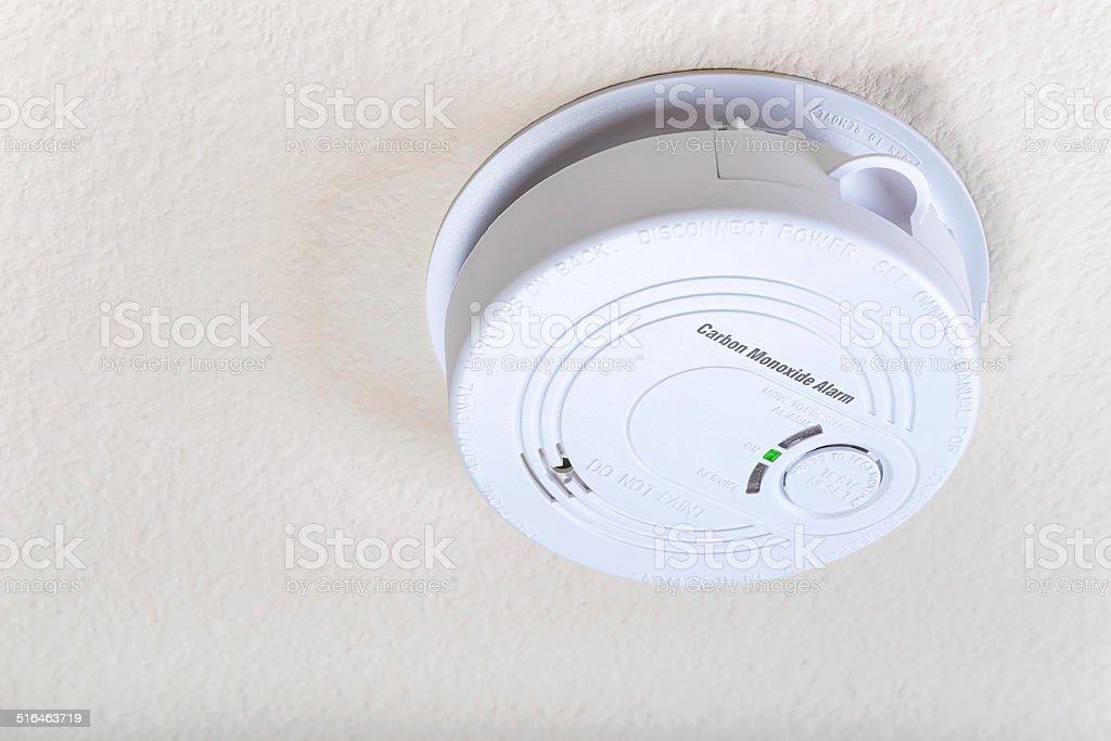 Carbon monoxide alarm on the ceiling stock photo