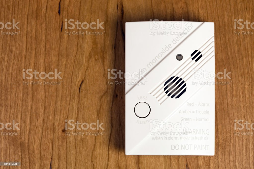 Carbon Monoxide Detector on Cherry Wood royalty-free stock photo