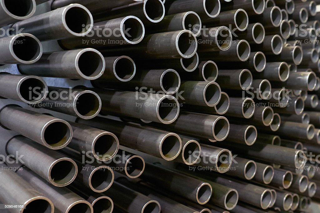 carbon steel tubes background stock photo