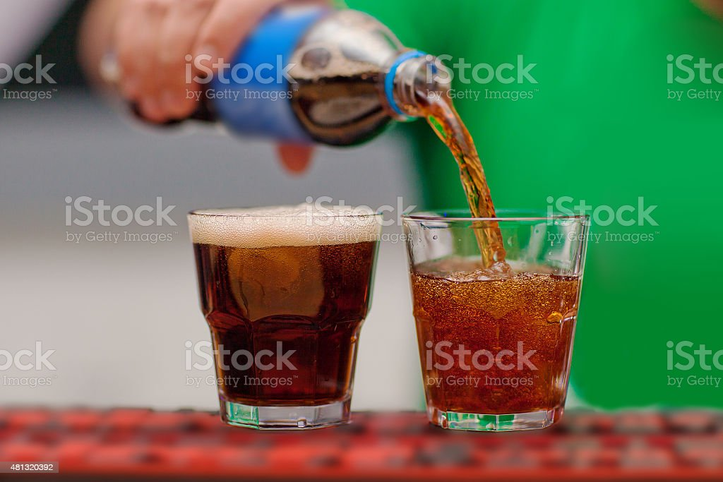 Carbonated drink poured into a glass stock photo